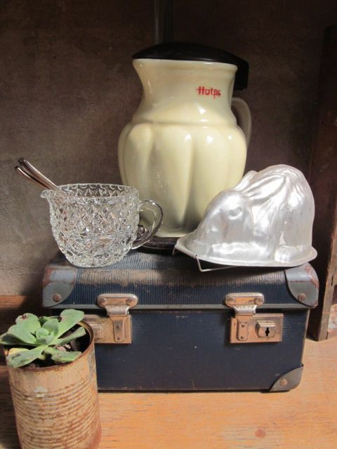 Easter inspired vintage styling with bunny, kettle and small suitcase.