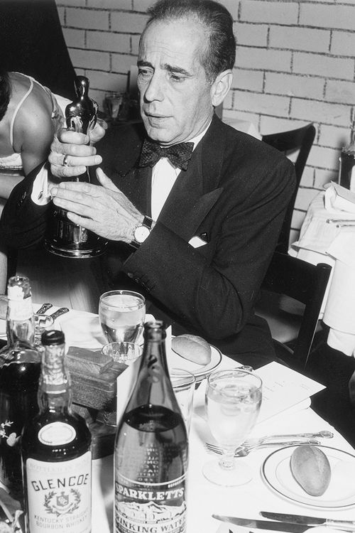 Humphrey Bogart his oscar for Best Actor, at the 24th Annual Academy Awards, 1951.