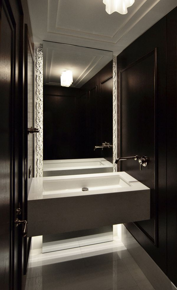 DECORATING DARKLY: A Selection of Inky Spaces A gorgeous powder room, complete with black paneled walls. Interior design by dSPACE Studio.