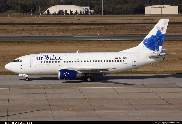 Air Baltic (LV) (Historic fleet) Boeing 737-53S YL-BBE aircraft, with ''a dancer in a blue dress'' motif on tail fin, skating at Germany Berlin Tegel International Airport. 30/11/2005.JetPhotos