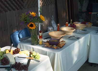 Wooden Bowls Buffet Table Setting  http://www.divinedinnerparty.com/buffet-table-setting-idea.html#