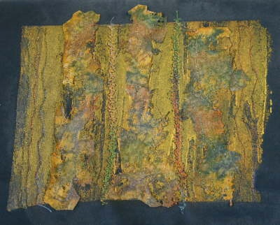 Image submitted by Jane Vella. Layers of Lutadur 130 painted with procion dye, zapped and decorated with Lutradur beads & 'Treasure Gold'.