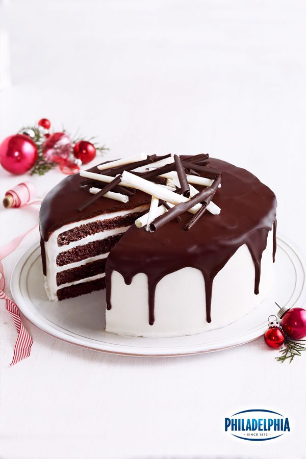 If you have to dress up for the holidays, you are going to need an elegant cake to match. This dramatic Tuxedo Cake makes the perfect dining room accessory for any special occasion dinner or party!