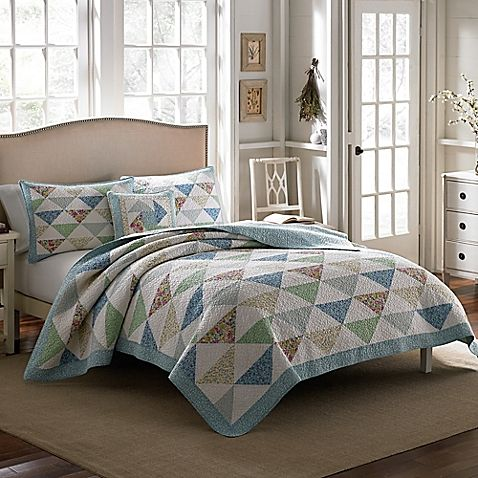 Lend a touch of charm to your bedroom's décor with the Laura Ashley Theodora Quilt. The lovely bedding combines a mixed palette of sky blues, spring greens, berry pinks and pale yellow in a beautiful patchwork of mini floral prints.