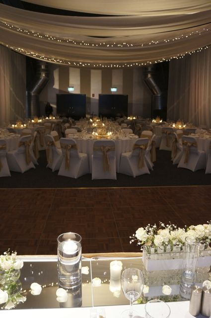 An eclectic mix of flowers and candles set the table.  Roof draping is available without the wall draping.  Fairy lights across the roof are also available as isolated event theming.  Contact us for a quote for your event or wedding reception.  http://www.tailracecentre.com.au/contact/