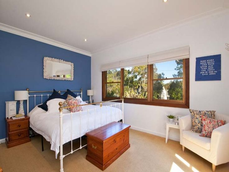 Modern bedroom design idea with carpet & sash windows using blue colours - Bedroom photo 140069