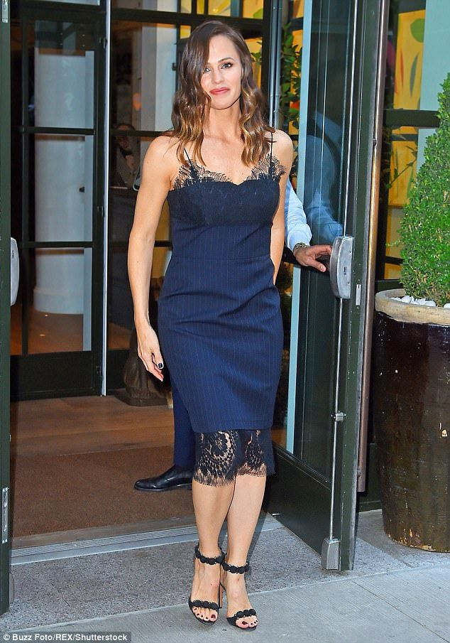 Flirty and feminine: Jennifer Garner showed off her slender body in a form-fitting frock as she left her hotel in Manhattan on her way to The Late Show With Stephen Colbert on Thursday