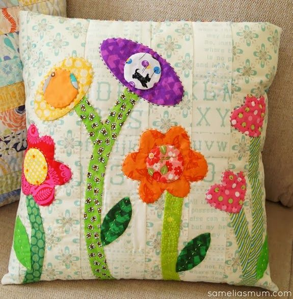Flower Garden Cushion.  And I like it because there is a Nikki dog.