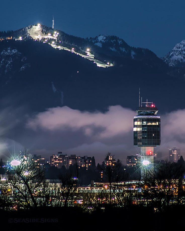 Cleared For Landing   Night skiing on Grouse Mountain. One of our bragging rights here in Vancouver and one of three local ski resorts that overlook our beautiful city. Fog rolls in from the east and creeps over the highrises in Kerrisdale on the west side of Vancouver. The air traffic control tower welcomes arrivals at Vancouver International Airport  (YVR) on Sea Island. Captured Saturday night on Lulu Island in Richmond BC  January 2 2016