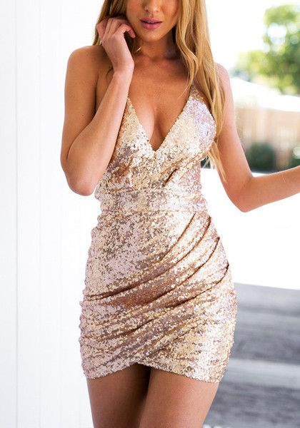 Glitz and glamour. This stunning rose gold sequin cocktail slip dress is designed with a V neck supported by thin spaghetti straps, connecting its racerback with caged detailing. | Lookbook Store Dress