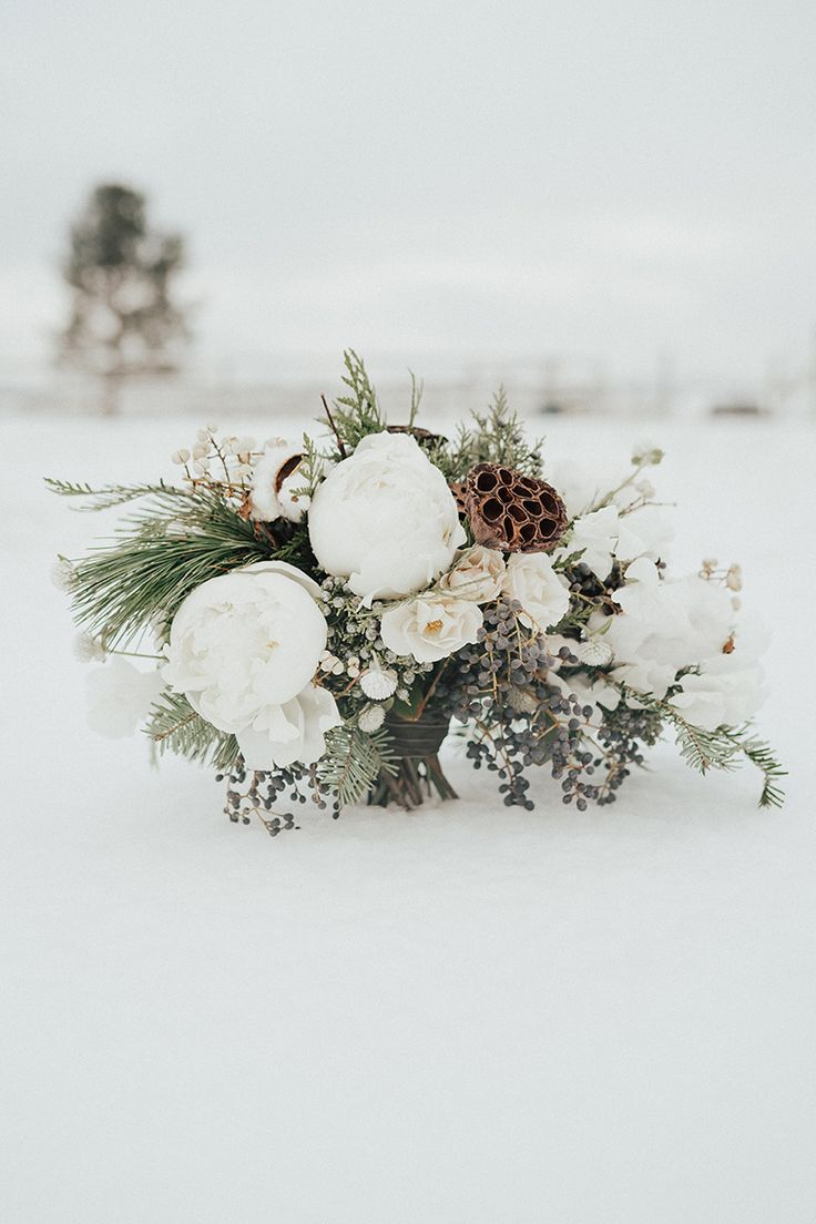 Winter bouquet inspiration created by florist Mum's Flowers. Snow Covered Winter Wedding Inspiration via Rocky Mountain Bride