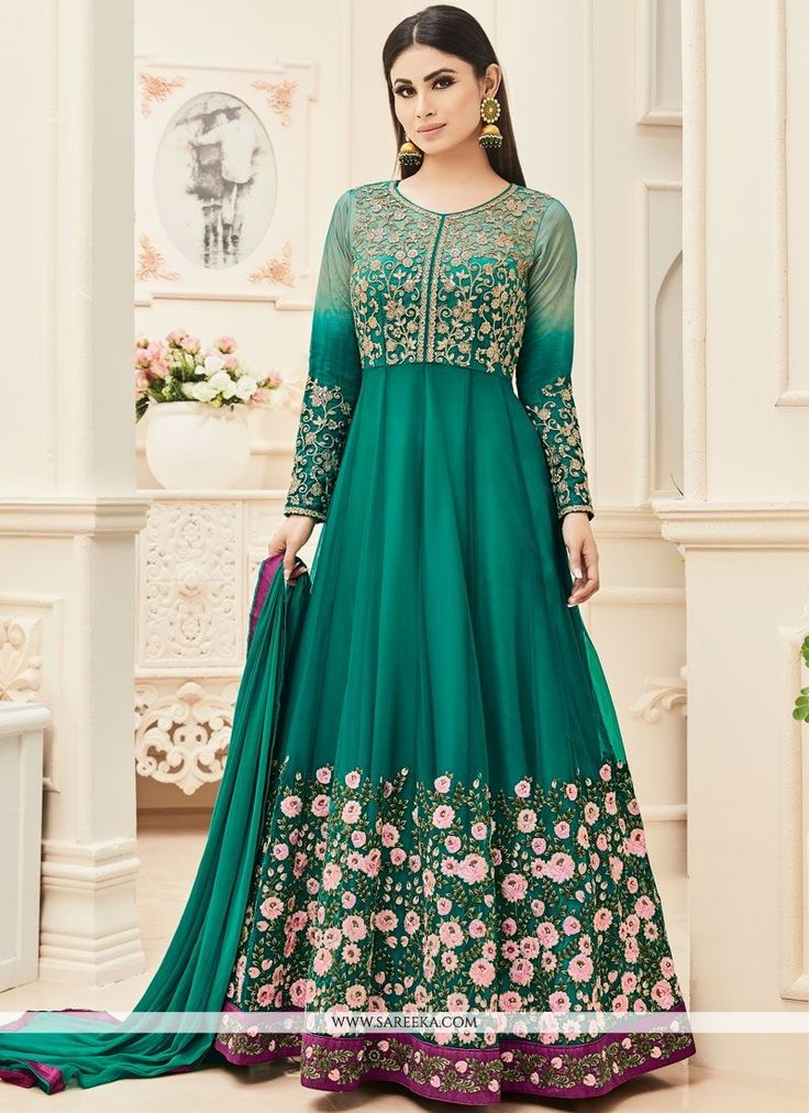 Look sensationally awesome in this sea green net Mouni Roy floor length anarkali suit. This ravishing attire is amazingly embroidered with embroidered and resham work. Comes with matching bottom and d...
