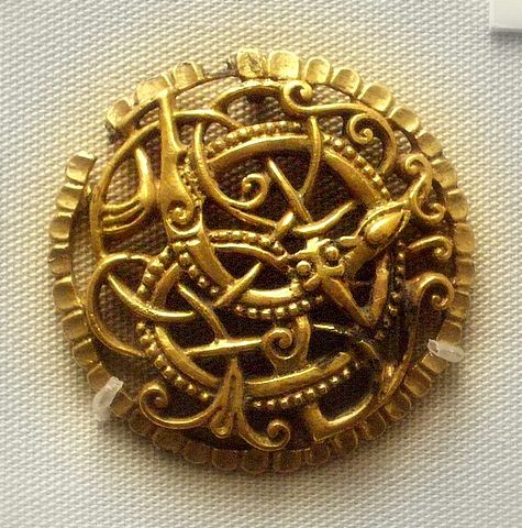 9-11c Anglo-Viking style brooch of gilded bronze in Urnes style. British Museum