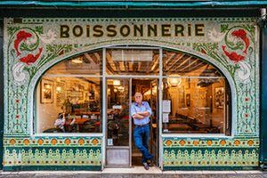 """""""In 1905, this fish and wine restaurant was a fishmonger (poissonnerie). When Drew Harré (pictured) and business partner Juan Sánchez bought it they changed the """"p"""" to a """"b""""."""" - Paris shop fronts photographed by Sebastian Eras. #typography"""