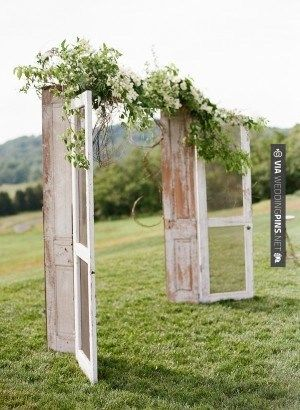 So awesome - i love this idea for your arch! just buy two really old doors or else just by doors and distress them (good project for me) and then connect them with a piece of ply wood so it will stand and then cover the wood with flowers or babies breathe! lol ----I love this!!!