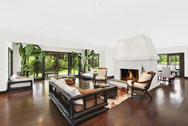 Tour Scarlett Johansson's New Hamptons Hideaway // White fireplace