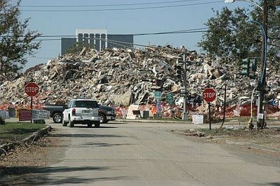 Debris pile post-Katrina, NOLA at West End. Three-four storeys high from devastated homes along the Lake Front.