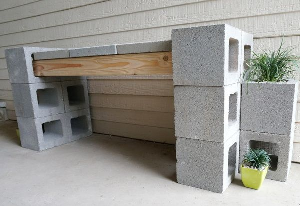 Cinder Block bench using 2x4's instead of beams and a couple of concrete pave stones on top of the 2x4's.  I'd need a cushioned pad of some type on top of those paver stones but this too is doable.