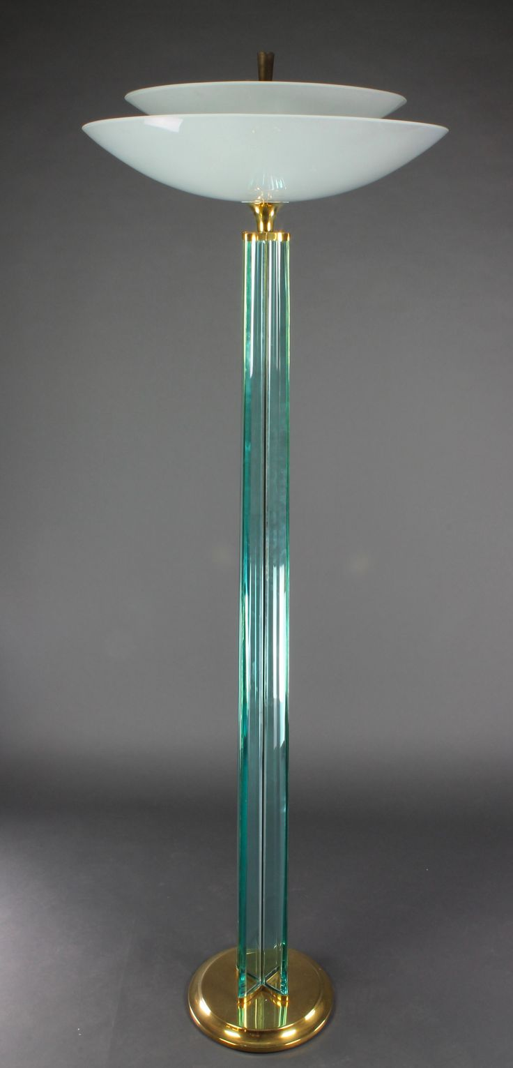 """Lots 1034 and 1035, GIO PONTI designed A handsome Art Deco style glass and gilt mounted uplighter, formed from 4 straight sections of glass and with opaque glass shade etched signs of the Zodiac 73""""h x 24"""" diam., est, £200-400 each"""