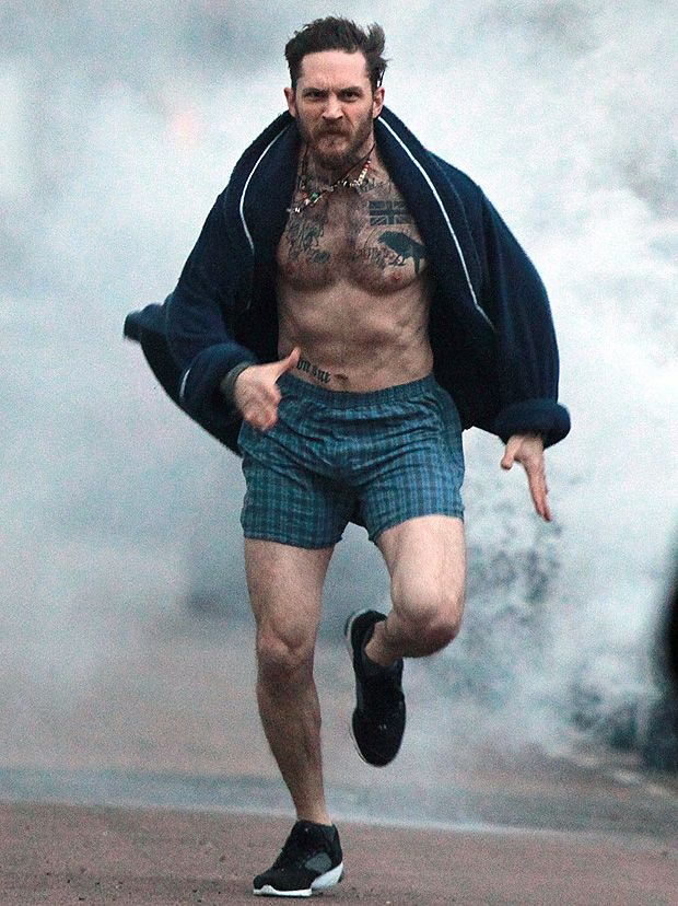 Picture exclusive of actor Tom Hardy running through London in boxer shorts and dressing gown for photoshoot