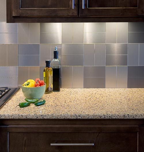 Aspect peel and stick back splash tile - This bar area is flanked with a basketweave of alternating brushed champagne and brushed stainless both long grain