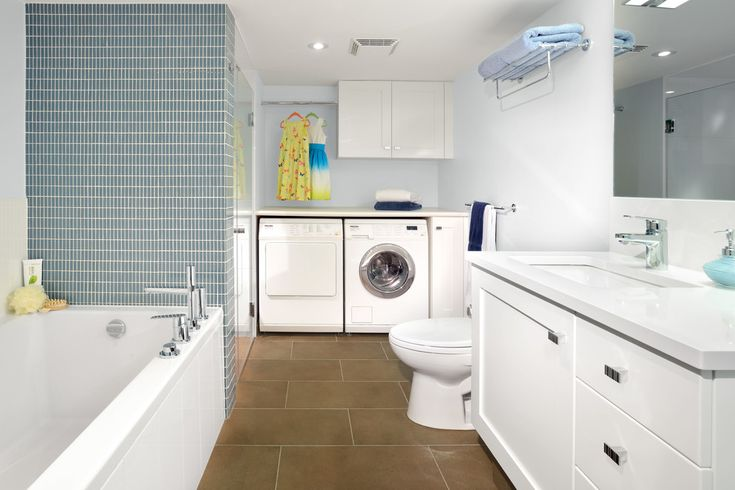 White Accent Basement Bathroom with Hanging Rod Laundry- Storage