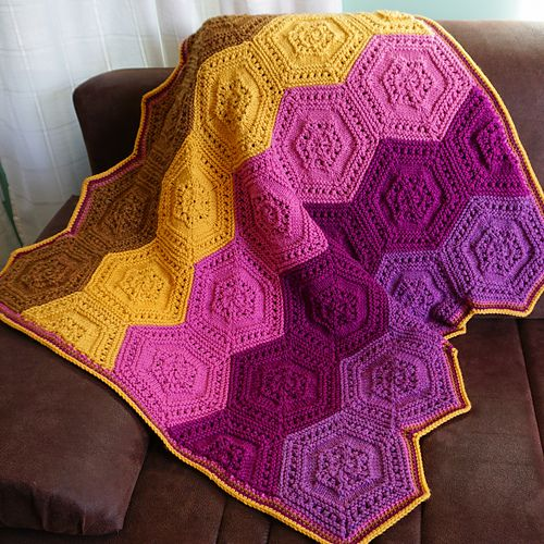 Very simple and very fun! Hexathrow is a throw made out of hexagons which are knit individually, and then seamed together. Each hexagon is worked in the round from the cast-on edge to the center. The project is easily portable, and chunky yarn in beautiful colors makes the knitting fly by. Arrange the hexagons in whatever pattern you like! Throw in a few extra skeins for a hexablanket!