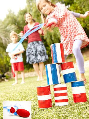 "Rocket Toss: carnival game made from recycled metal cans and homemade ""rockets."""