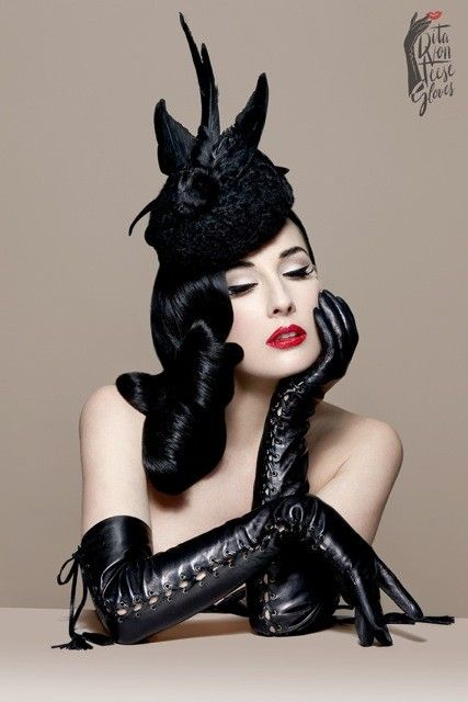 DITA VON TEESE | THE FETICHE GLOVE / Based on a long time obsession with fetishistic, elegance Dita Von Teese invites you to explore your sensual side with her luxury glove collection. These Fetiche gloves are crafted from supple black leather for winter warmth, and eyelets along the sides with hanging tassels.