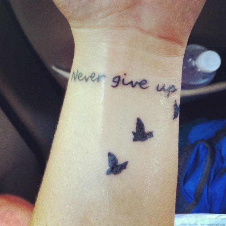 "My tattoo, ""Never give up"""