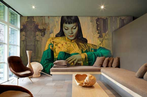 British fashion designer and cofounder of Red or Dead Wayne Hemingway's living room with Surface View wall mural from the Land of Lost content.