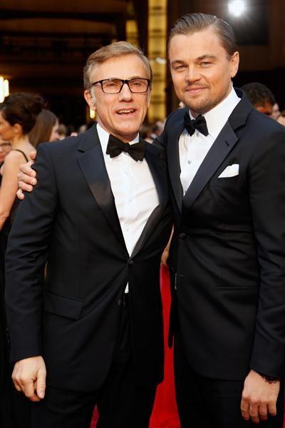 Christoph Waltz y Leonardo DiCaprio en la alfombra roja de la entrega 86 de los premios Oscar 2014 desde el Dolby Theatre de la ciudad de Los Ángeles, el 2 de marzo de 2014.