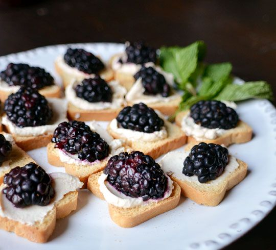 easy appetizer- mini toast, goat cheese, (or cream cheese) and blackberries - together with a glass of wine - great start to the evening