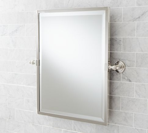 Image Of This adjustable mirror is ideal for a shared bath because it lets each person find the perfect viewing angle Sturdy wall brackets let it pivot and stay put