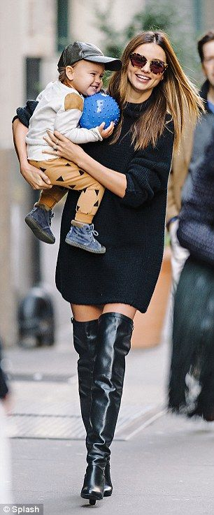Miranda Kerr in black oversized sweater dress and black thigh high boots