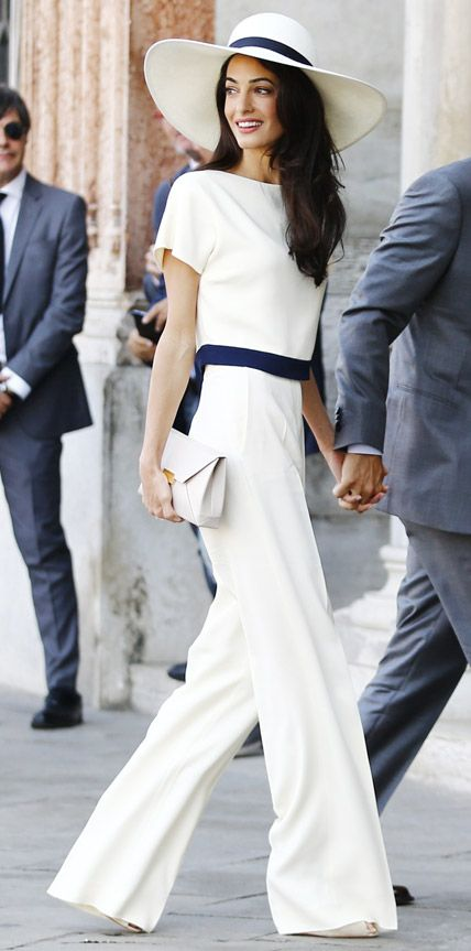 To wrap up her wedding festivities with a civil ceremony at Venice's Municipal Building, the new Mrs. Amal Clooney stunned in a chic ivory-and-navy top (that matched her wide-brimmed hat) and ivory pants with a neutral clutch—all by Stella McCartney. September 28, 2014 from #InStyle