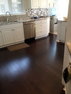 Captivating Beautiful Kitchen With Dark Hardwood And Modern Backsplash By Riemer Floors.  #whitecabinets, #