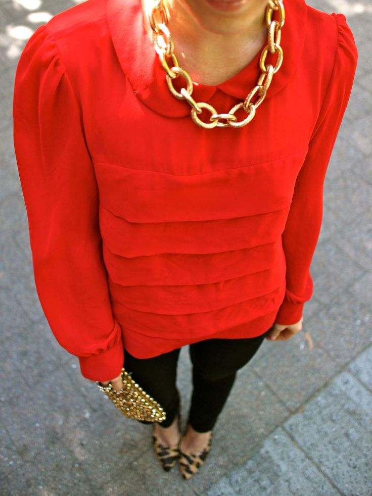 gold necklace, red top black pants, leopard heels