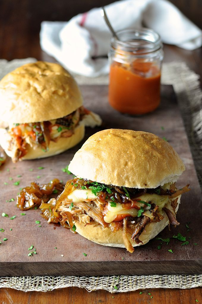 "Soft rolls piled high with juicy pulled pork, enchilada sauce, gooey cheese and caramelised onion (great frugal way of making things ""gourmet""!)"