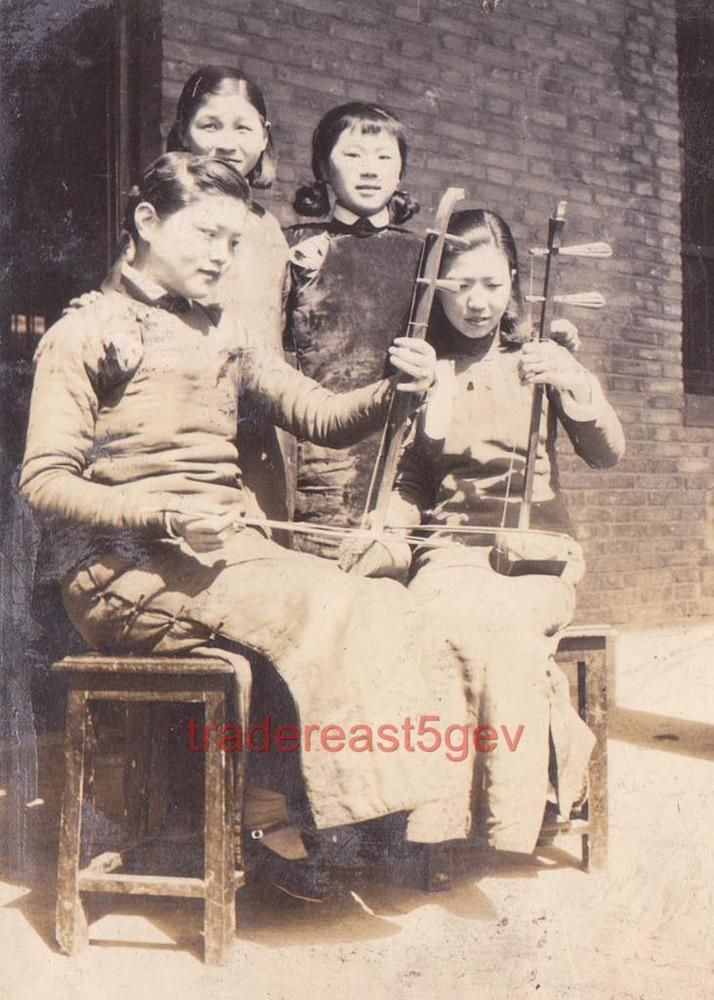 "Chinese Female Traditional Erhu Musicians in Shanghai 1930s 5x7 Photo Reprint  inches).  Digital reprint made from a ca. 1930s original photo found in a contemporary photo album that belonged to a Japanese Soldier.  The erhu ( 二胡) is a two-stringed bowed musical instrument, more specifically a spike fiddle, which may also be called a ""southern fiddle"", and sometimes known in the Western world as the ""Chinese violin"" or a ""Chinese two-stringed fiddle"". It is used as a solo instrument as well…"