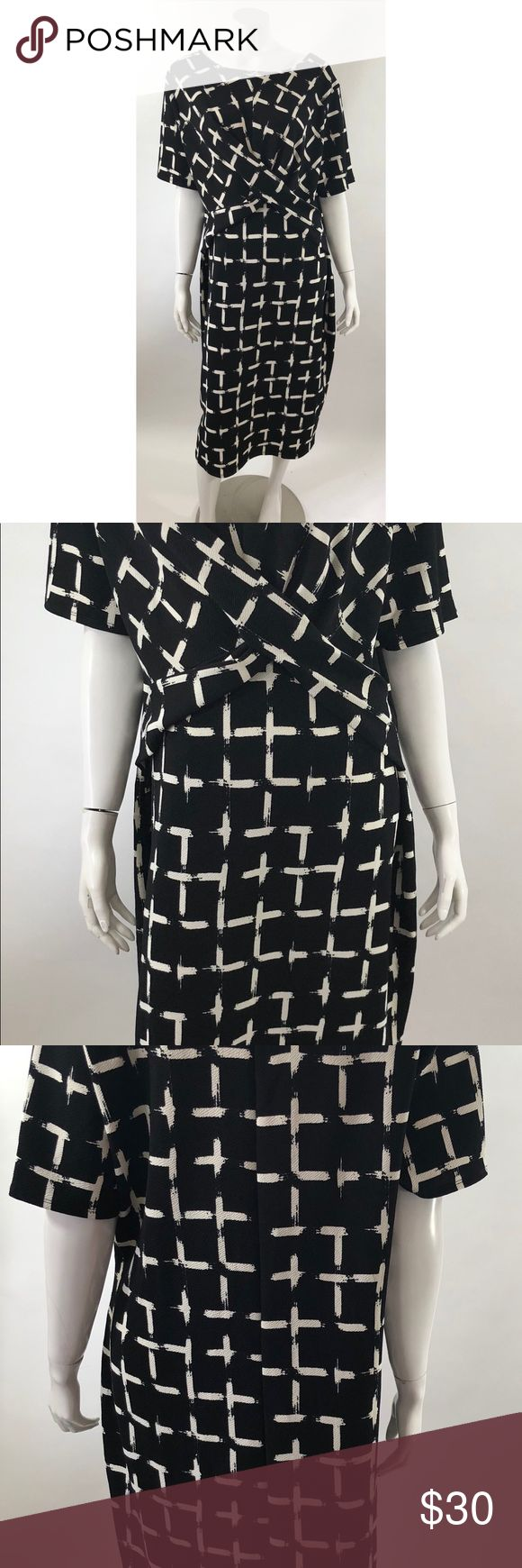ASOS Womens Dress Plus Size 22 Black White Sheath ASOS Womens Dress Plus Size 22 Black White Sheath Half Sleeve Career. Measurements: (in inches) Underarm to underarm: 24.5 Length: 45 Waist: 39  Good, gently used condition ASOS Dresses