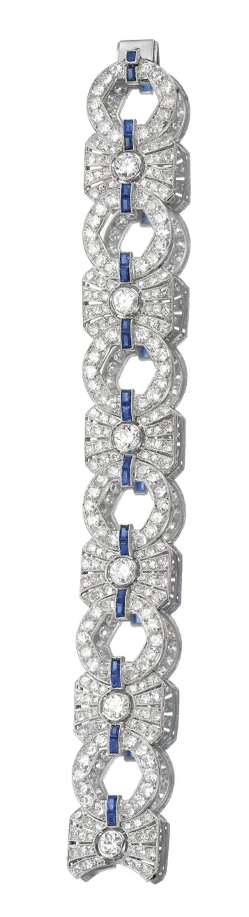 DIAMOND BRACELET, 1930s. Designed as a series of geometric links connected by calibré-cut sapphires, each rectangular link set to the centre with a circular-cut diamond, the links further pierced and millegrain set with circular- and single-cut diamonds, length approximately 185mm, French assay marks.