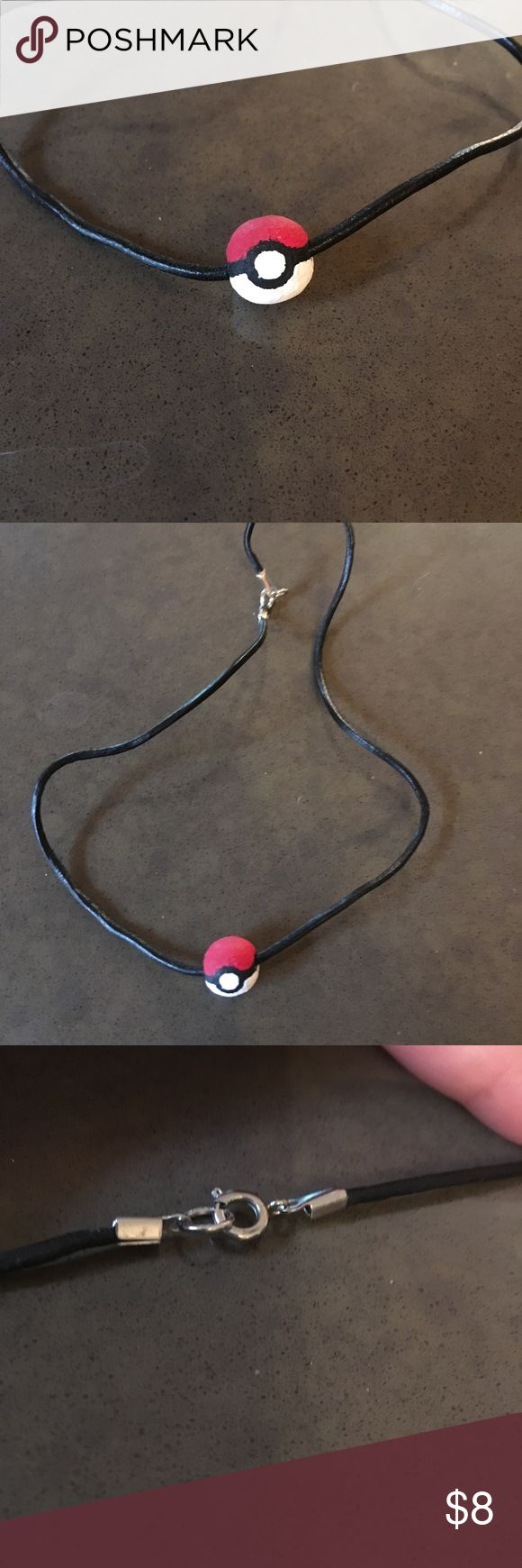🔵 pokeball choker necklace Cute and unique choker necklace featuring a pokeball charm! It is a wooden bead painted using acrylic paint. The cord is faux leather and has a silver tone circle clasp. Clasp is lead and nickel free.  Blue dot 🔵 sale: one item for $8, two items for $12 or three for $15. Jewelry Necklaces