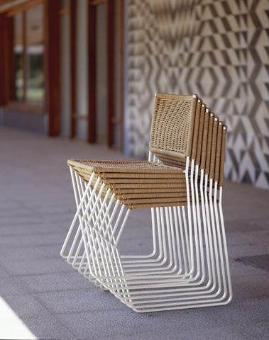 Sillam Ramon by Ramon Bigas (1975) stackable wicker and white metal chairs