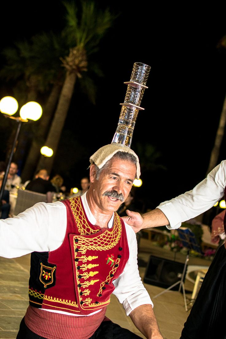 Greek Dancing with glasses in Larnaca - Cyprus Tradition