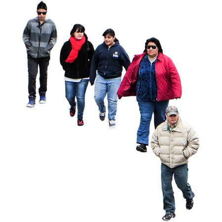 Cutout photo of five people walking in the street, taken from an overhead view.