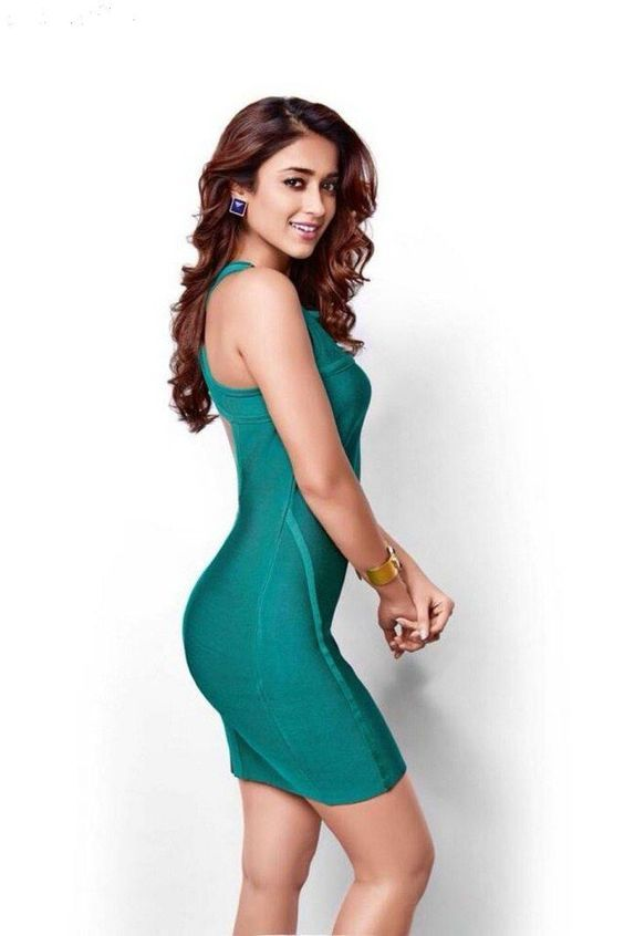 Ileana in  a sexy figure hugging dress.
