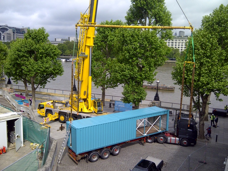 Crane lifting last shipping container to create new Wahaca restaurant - Southbank, London
