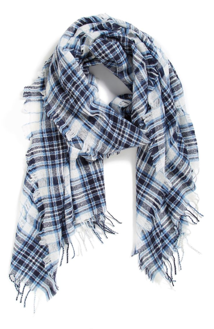 The lightweight feel of this plaid Madewell wool scarf helps keep warm without feeling too heavy, and is perfect for transitioning from summer to fall.
