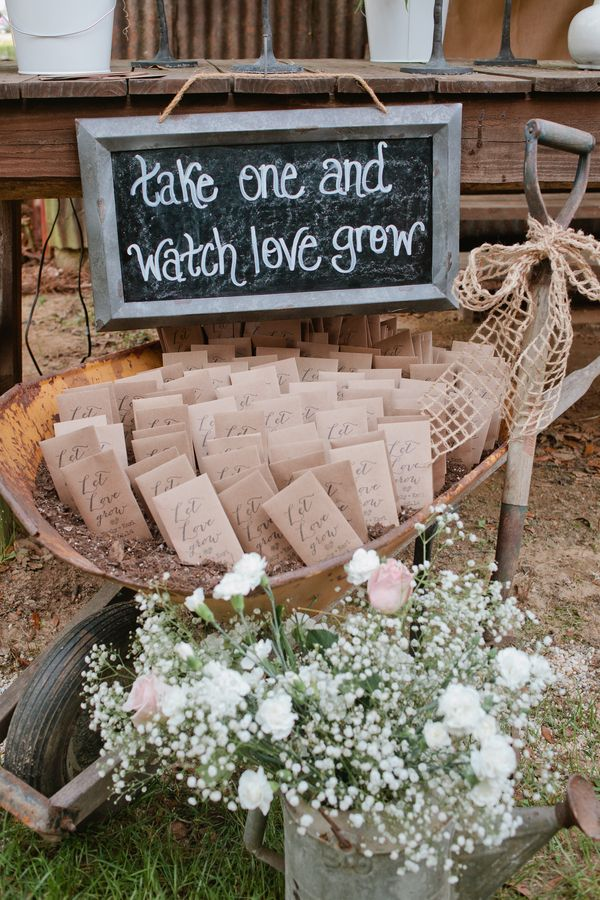Packets of seeds were an ideal springtime favor.   	Photo by Freshly Bold Photography 	Venue: Private Barn 	Floral Design by Flowers by the Shore 	Rentals by SOHO Events and Rentals